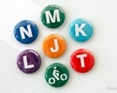 "a set of seven 1"" MUNI rail lines / bikelane button magnets"