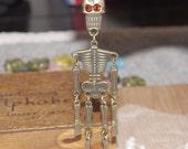 2 pcs The walking skeleton pendant-with topaz glass eyes-F466