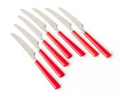 Vintage dinner knives, bright red handles with stainless steel blades, lucky set of 7