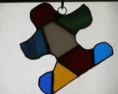 Stained glass Puzzle Piece - Autisim symbol