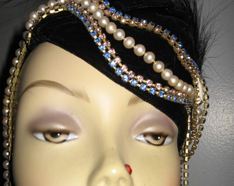 Handmade black velvet skull cap adorned with pearls and rhinestones and an egret feaher