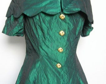 """Emerald green """"wrinkled"""" taffeta with scalloped portrait collar off the shoulder"""