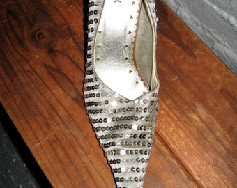 Silver sequined, very pointy toes pumps