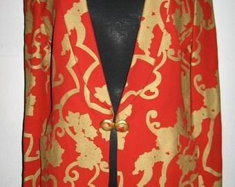 Stunning handprinted gold design on red jacket