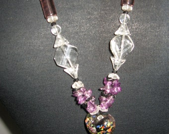 Fun long necklace  of faux amythest and clear plastic beads