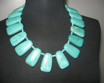 Striking faux turquoise rectangular bead necklace