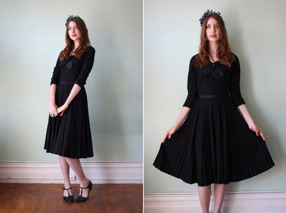 vintage 1950's black dress with satin trim & pleated skirt / size s
