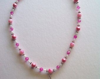 Spider Dangling From Pink Glass Bead Necklace