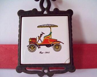Vintage Ceramic Tile of Antique 1905 Reo in Cast Iron Trivet