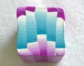 polymer clay cane, checker swatch in warm blue and raspberry pink