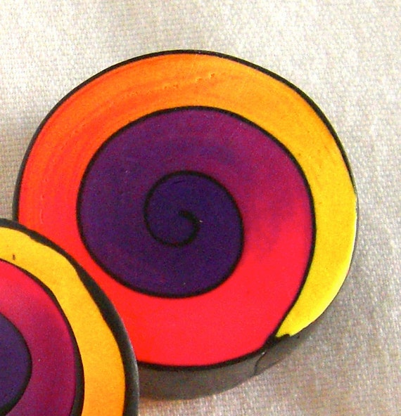 polymer clay cane in dark purple, pink and yellow