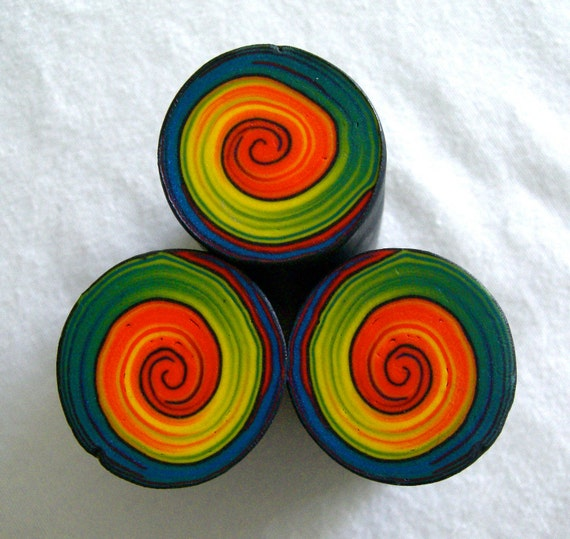 swirl polymer clay cane in red, yellow, green and blue