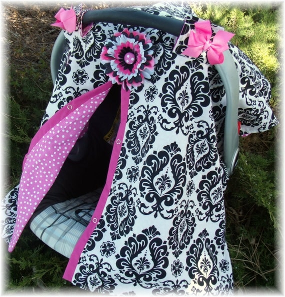 Girl Carseat canopy in Hot pink polka dot damask with flower clip and bows