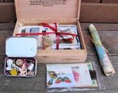 On reserve for Rachel-Cigar box full of altered art supplies