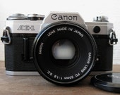 Classic vintage Canon AE-1 camera with Canon FD 50mm 1.8mm lens. Perfect working condition..