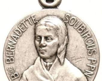 Saint BERNADETTE SOUBIROUS Patron Saint Vintage Religious Medal signed by TSCHUDIN on 18 inch sterling silver rolo chain
