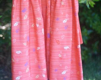 Pleated Mid-Length Salmon-Colored Print Skirt