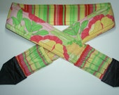 Tropical Sherbet camera strap, reversible, 2 expandable pockets with stretchable elastic.Dark red and black.