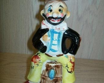 Decanter Ceramic Bum or Clown Sitting on the Barrel 1980