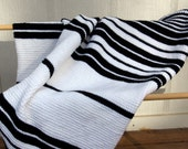 Black and white variable striped lap blanket