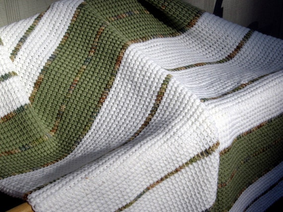 Olive green striped blanket with variegated accent rows on a white background