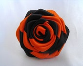 Handmade roses ribbon flowers in two tones --- orange and black