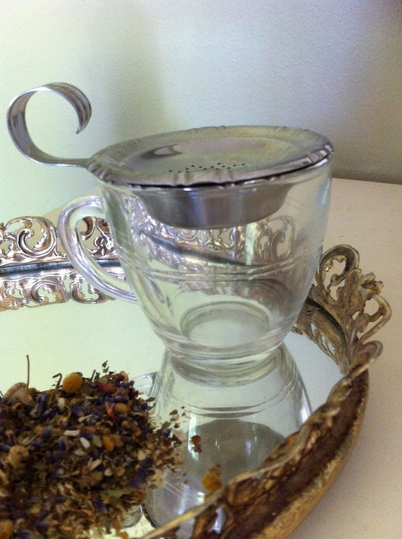 Vintage Tea Strainer with Caddy and Teacup