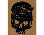 Cat and Skull lino-cut greeting card
