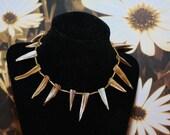 Gold and tan glass beadwork with shell beads like animal teeth