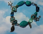 Blue and Turquoise Charm bracelet with glass beads