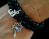 Reserved for hlaibach, Lotus and Om Stretch Bracelet With Black Wood Beads :)