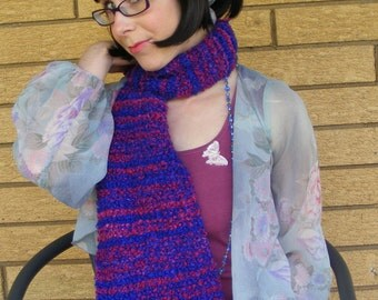 Pink and purple fuzzy knit scarf.