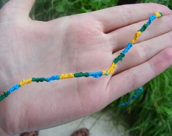 Green, blue and yellow friendship bracelet