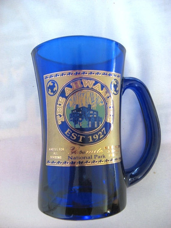 Ahwahnee Hotel blue glass souvenir mug, gold label Yosemite Park