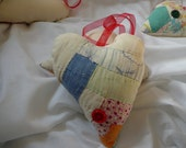 Ouilt heart made from a vintage log cabin quilt