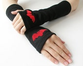 Red Bat and Black Arm Warmers