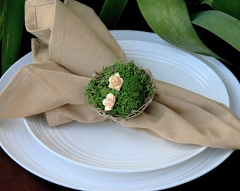 Bird nest napkin rings with mini roses.