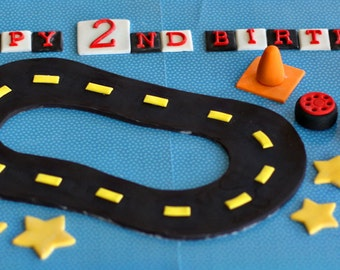 Fondant Race Track, Wheels, Construction Cones, Stars and Happy Birthday Message for Decorating a Birthday Cake