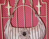 pink and brown striped slouch purse with flower