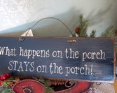 Rustic, midnight blue porch sign with message 'what happens on the porch STAYS on the porch'