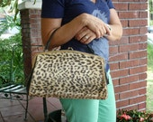 RESERVED. vintage leopard handbag with kiss clasp