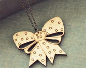SALE. polka dot wooden bow necklace.