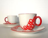white and red Cup with Saucer