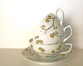 elegant white Tea cup with golden and black - hand painted