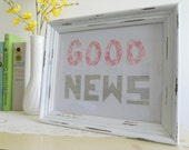 White shabby framed good news sign