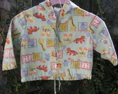 Take me to the zoo, vintage jacket in pale green with colorful zoo animals for your peanut. vintage sz. 18 months