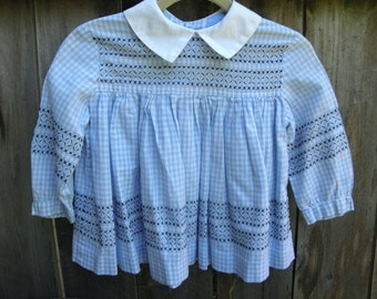 Precious blue gingham dress with hand stitched detail. Size 2.