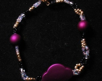 Purple and Gold Beaded Bracelet, with seed beads and other. Free shipping. #lizzywallaceart