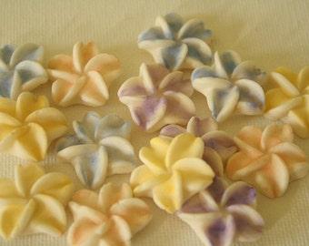 Small edible gumpaste sugar flowers for cake decorating