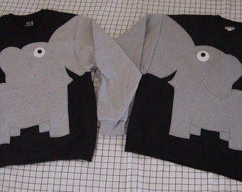 Pair of elephant shirts holding trunks in your choice of color and size